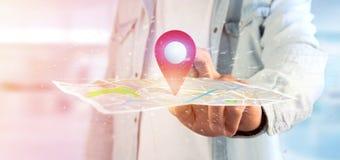 供以人员拿着在地图的一个3d翻译别针持有人 库存照片