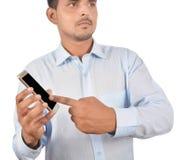 供以人员拿着黑屏智能手机专业地被隔绝在w 库存照片