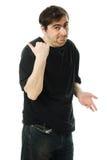 供以人员点在他的之后的一个手指。 免版税库存照片