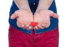 供以人员与红色心脏的身分在手上,隔绝在白色背景 免版税库存照片