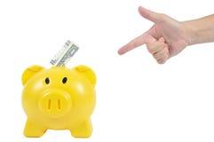 供以人员与黄色贪心银行的手行动,企业概念 库存图片
