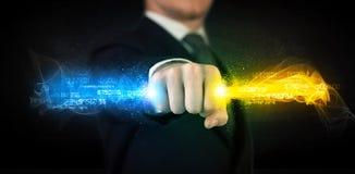供以人员举行五颜六色的发光的数据在他的手上 免版税库存图片