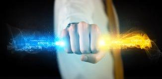供以人员举行五颜六色的发光的数据在他的手上 库存照片
