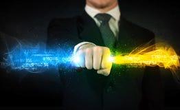 供以人员举行五颜六色的发光的数据在他的手上 免版税库存照片