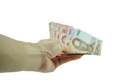 供以人员举行显示在白色背景的泰国钞票 库存图片