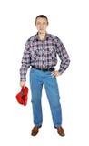 供以人员佩带的牛仔裤和一件格子花呢上衣有红色盖帽的 免版税库存照片