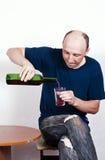 供以人员倾吐的酒入玻璃 库存照片