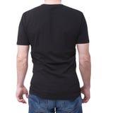 供以人员在与拷贝空间的白色背景隔绝的佩带的空白的bllack T恤杉 T恤杉设计和接近人的概念- 图库摄影