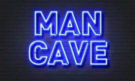 供以人员在砖墙背景的洞霓虹灯广告 免版税库存图片