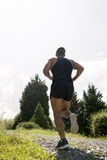 供以人员在路下的赛跑每晴天 库存图片