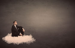 供以人员坐一朵云彩有简单的背景 库存照片