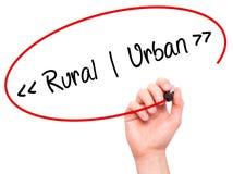 供以人员手写农村-都市与在视觉scree的黑标志 免版税图库摄影