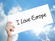 供以人员手对负纸与我爱欧洲的文本 在白色p的标志 库存例证