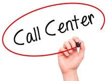 供以人员手文字与黑标志的电话中心在视觉屏幕上 免版税库存图片