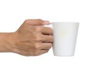 供以人员拿着一个陶瓷杯子被隔绝在白色 免版税库存照片