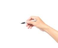 供以人员拿着在白色背景的手一支黑记号笔 免版税库存图片