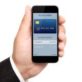 供以人员拿着有流动钱包onlain购物的手电话  库存图片