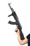 供以人员拿着AK-47机枪被隔绝在白色 免版税库存照片