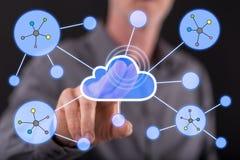 供以人员接触在触摸屏上的一个云彩网络 库存图片