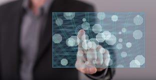 供以人员接触在触摸屏上的一个抽象网络概念 库存图片