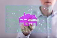 供以人员接触在触摸屏上的一个数字式聪明的家庭自动化概念 免版税库存图片