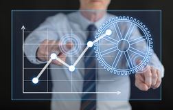 供以人员接触在触摸屏上的一个数字式经营分析概念 免版税库存图片