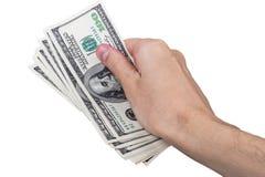 供以人员有在白色背景隔绝的100美金的手 免版税库存图片