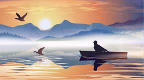 供以人员漂浮在湖的一条小船 库存照片