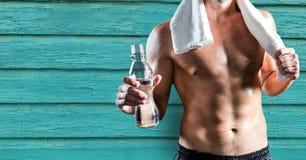 供以人员身分反对蓝色木背景在锻炼以后 免版税图库摄影