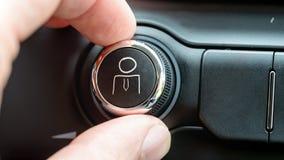 供以人员转动按钮与一个拉长的企业人 库存图片