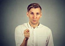 供以人员给拇指,手指您什么都没得到零的figa姿态 免版税库存图片