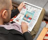供以人员读查理Hebdo admirng王牌希尔顿动画片 免版税库存图片