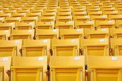 供以座位体育场黄色 免版税图库摄影