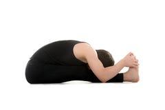 供以座位的向前弯瑜伽姿势 图库摄影