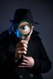 侦探玻璃放大器 免版税库存图片