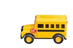 侧视图二切开了在白色背景,对象,拷贝的黄色玩具汽车 免版税库存照片