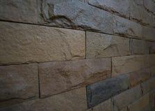 侧视图浅褐色的砖墙样式 免版税库存图片