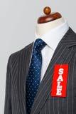 侧视图灰色细条纹衣服销售 免版税图库摄影