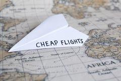 便宜的飞行/便宜地飞机票 库存照片