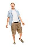便衣白色backgr的全长可爱的年轻人 免版税库存照片