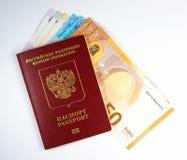 俄国人外国护照和50欧元 图库摄影