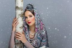 俄国女孩画象有桦树的 免版税库存图片