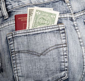 俄国护照和两笔记关于一美元在臀部口袋 免版税图库摄影
