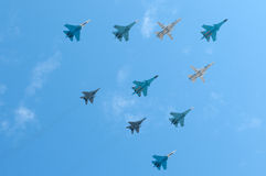 俄国空军苏霍伊苏-34、3个SU-24M、4苏-27和2米格-29 免版税库存照片