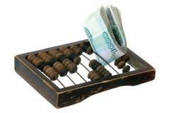 俄国货币和老算盘 免版税库存照片
