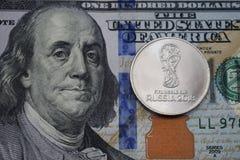 俄罗斯、圣彼德堡、硬币世界杯足球赛俄罗斯2018年和美元 免版税库存照片