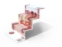 5000俄罗斯卢布作为在白色背景的步被折叠的钞票 库存照片