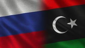 俄罗斯和利比亚-两一起旗子-织品纹理 库存图片