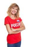 从俄罗斯的笑的妇女有横渡的胳膊的 免版税库存照片