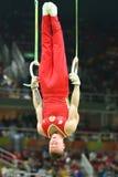 俄罗斯联邦的丹尼斯Abliazin竞争在人` s圆环最后在艺术性的体操竞争在里约2016奥运会 图库摄影